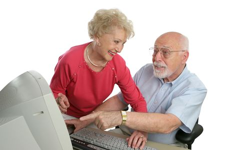 computer instruction: A senior lady teaching a senior man how to use the computer. He has a question.  Isolated on white.