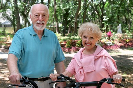 An attractive senior couple out for a bike ride together. Stock Photo
