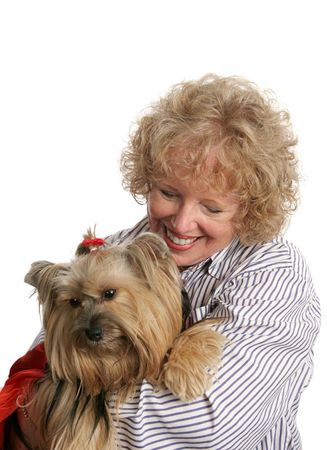 breeder: An affectionate pet owner giving a hug to her little yorkie dog.  Isolated. Stock Photo