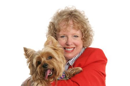A pretty red-haired woman holding her adorable pet yorkshire terrier. photo