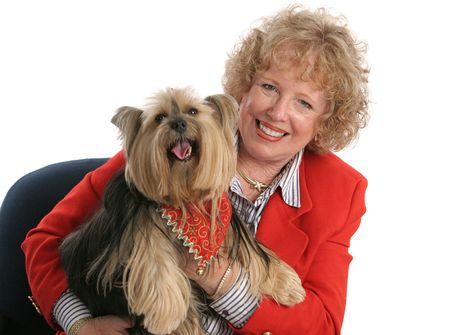 A pet owner and her beloved yorkshire terrier - both are wearing red.