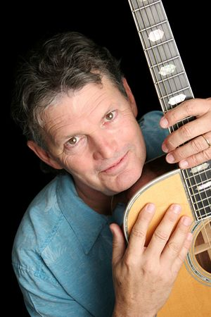 beloved: A handsome, experienced middle-aged musician with his beloved guitar. Stock Photo