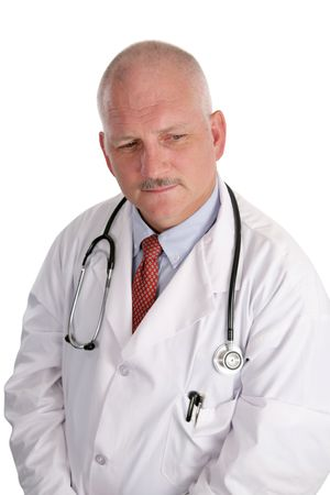 A handsome, mature doctor worried about a patient's health. Stock Photo - 484136