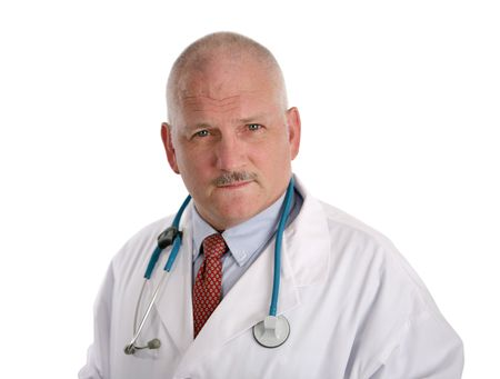 A handsome, mature doctor with a concerned expression, isolated on white. Stock Photo - 484125