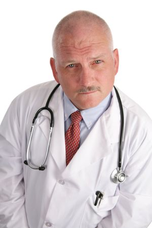 A portrait of a handsome, mature doctor with a serious expression.
