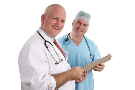 A horizontal view of two handsome, smiling doctors holding a patients chart.  Isolated. (focus on doctor in foreground) photo