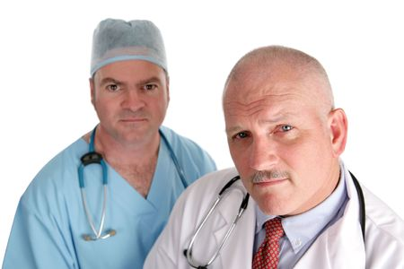 Worried looking doctors isolated on white photo