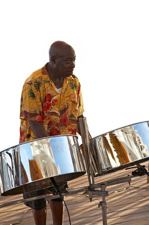A caribbean musician playing his steel drums.
