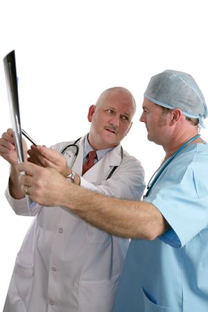 Two doctors consulting on an xray, prior to surgery. photo