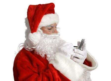 saint nick: Santa Claus checking his