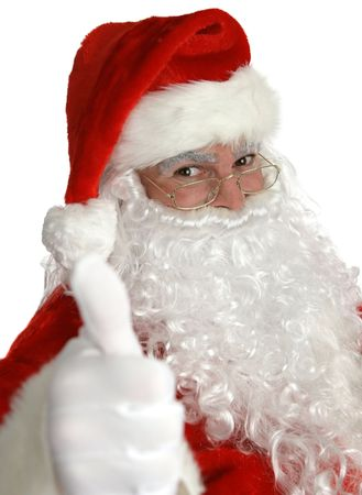 santa clause hat: A portrait of Santa Claus giving a thumbs up sign.