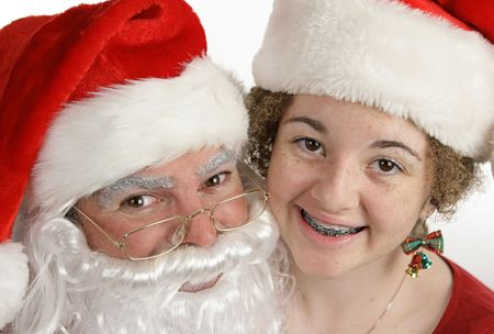 Santa posing with a little girl with braces. photo