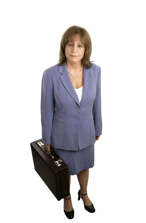 A full body view of a competent, attractive businesswoman holding a briefcase. Isolated.