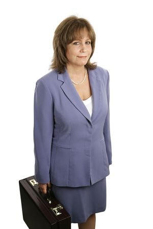 competent: An attractive, competent looking business woman in a blue suit with a briefcase. Stock Photo