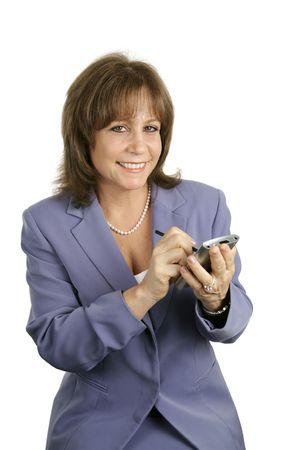 A pretty businesswoman using her PDA.