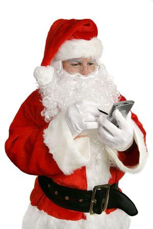 updated: Un Pap� Noel actualizado que comprueba su lista en PDA. Aislado en blanco.