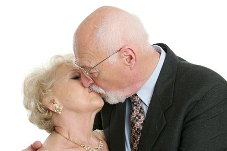 romance: A senior husband and wife locked in a romantic kiss. Stock Photo