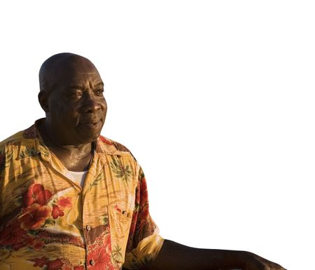 A caribbean man on a white background with room for text. Reklamní fotografie
