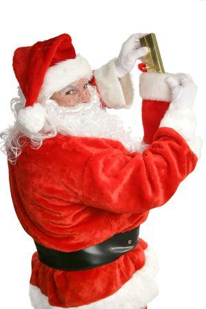 opvulmateriaal: Santa Claus opvulmateriaal een kerst opslag. Focus op Santa's gezicht. Geïsoleerd op wit.