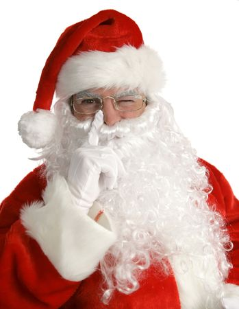 beiseite: Santa mit seinem Finger neben der Nase und mit einem Augenzwinkern. Isoliert auf Wei�.  Lizenzfreie Bilder