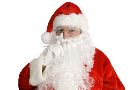 Santa Laying his finger aside of his nose and giving a nod...  Isolated on white. Stock Photo - 561054