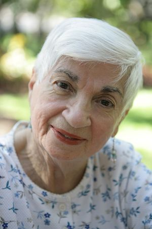 A closeup portrait of a loving, wise grandmother.  Shallow depth of field. photo
