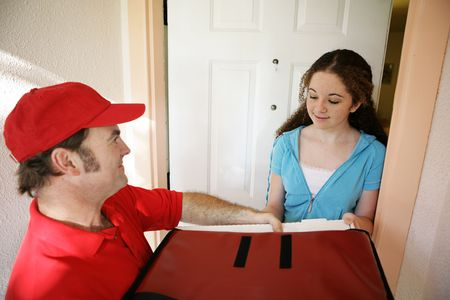 delivery service: A delivery man bringing pizza to a home.