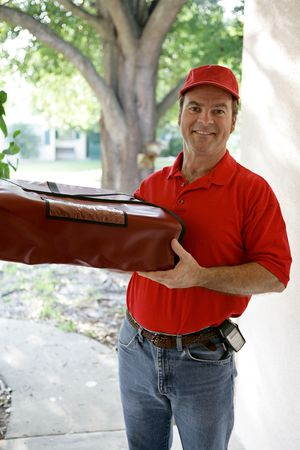 A handsome delivery man holding an insulated pizza delivery bag.