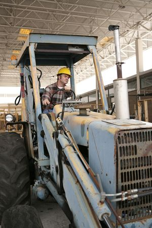 A construction worker operating a backhoe. photo
