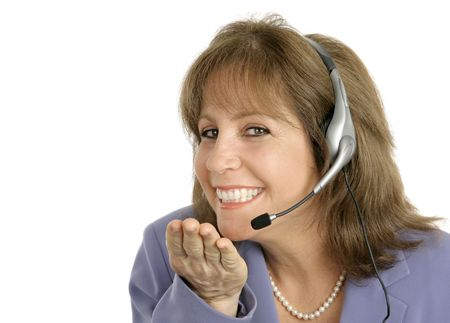 A customer service associate blowing a and smiling at you. photo