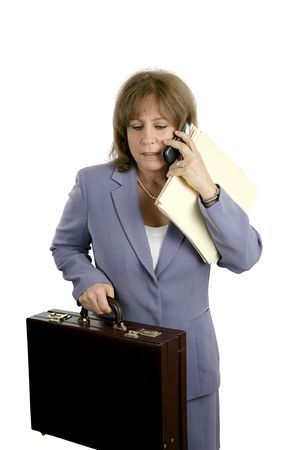A businesswoman trying to do too many things at once.  She is stressed & frustrated.  Isolated on white.