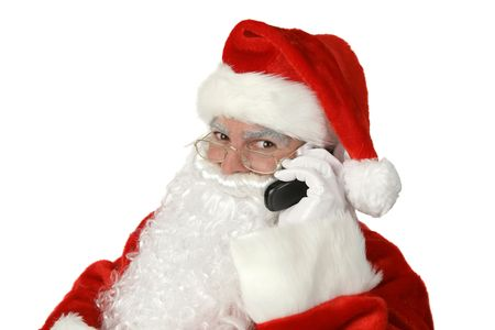 A traditional Christmas Santa Claus talking on a cell phone.  Isolated on white. Stock Photo - 604996
