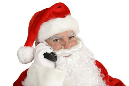 A happy, smiling santa claus on the telephone.  Isolated on white. Stock Photo - 605023