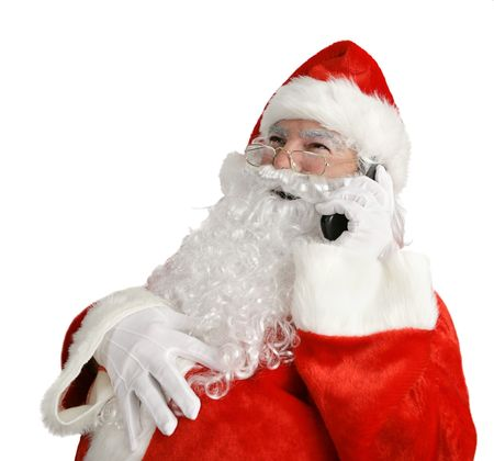 Santa laughing out loud as he talks on his cell phone.  Isolated on white. photo