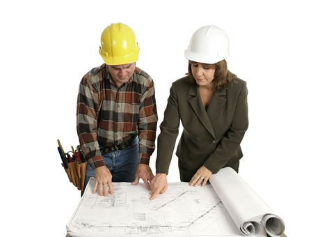 A female engineer and a building contractor reviewing blueprints.  Isolated on white.