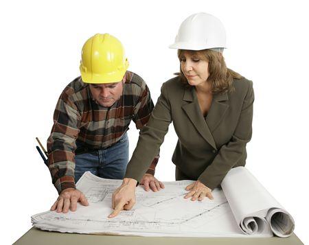 A female engineer going over the blueprints with a building contractor.  Isolated on white. photo