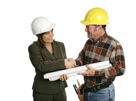 female architect: A female architect or engineer meeting with a building contractor.  Isolated on white. (focus on womans face)