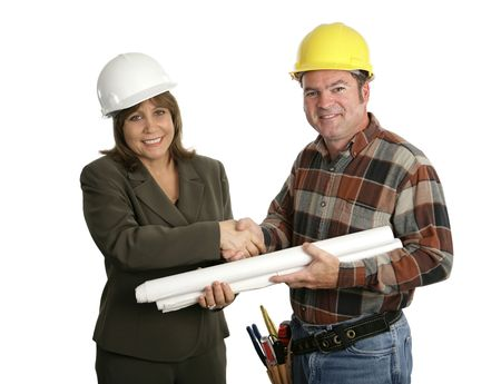 A female engineer and a building contractor shaking hands.  Isolated on white. photo