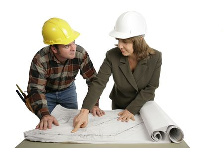 A female engineer going over blueprints with a building contractor.  Isolated on white. Stock Photo - 605013