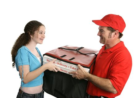 A customer happy to receive her pizza delivery from a friendly pizza man.  Isolated on white.