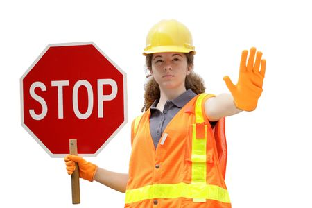 reflective vest: A female construction worker wearing reflective vest & holding a stop sign - isolated.