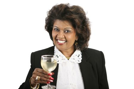 An attractive Indian woman in a business suit drinking a glass of white wine. Isolated on white. Stock Photo - 656824
