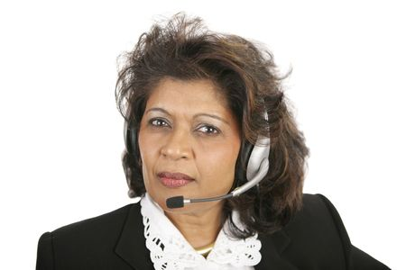 A caring, concerned Indian telephone operator.  Isolated on white. Stock Photo - 656826