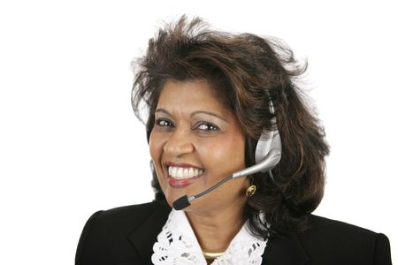english ethnicity: A beautiful Indian customer service agent with a telephone headset.  Isolated on white. Stock Photo
