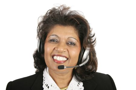 emerging markets: A pretty Indian customer service agent wearing a headset.  Isolated on white.