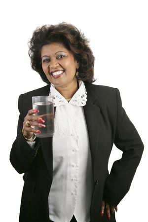 english ethnicity: An attractive Indian businesswoman drinking a glass of water.  Isolated on white.