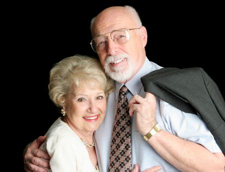A loving, handsome senior couple on a black background. Stock Photo - 685441