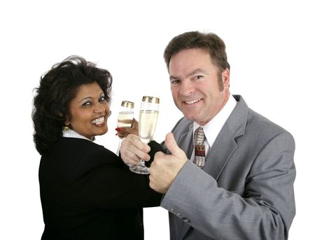 An attractive couple in suits toasting with champagne.  They could be dating or celebrating a business partnership. photo