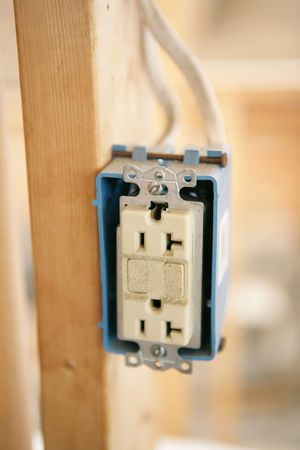 receptacle: Closeup of a three phase, gfi electrical receptacle in new construction.  Isolated, shallow depth of field.
