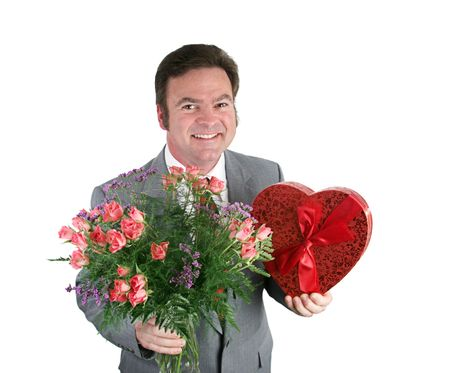 A smiling man holding roses and valentines candy against a white background. Stock Photo - 715328